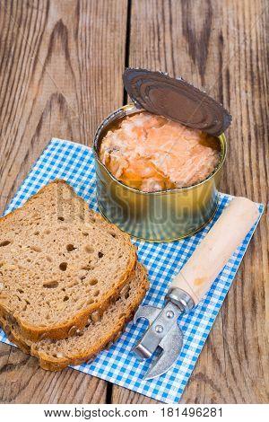 Canned fish salmon or tuna in open metal can. Studio Photo