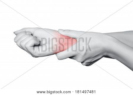 Closeup view of a young woman with pain on hand. isolated on white background. Black and white photo with red dot.