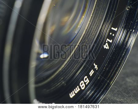 The manual lens on a dark background macro shot