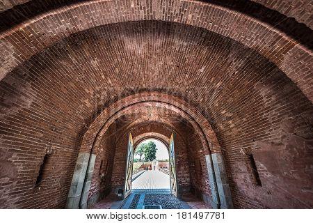 Main gate and bridge of 19th century military fortress in Daugavpils Latvia