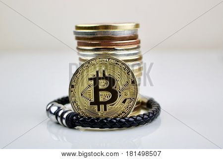 Cryptocurrency physical gold coin and mans bracelet