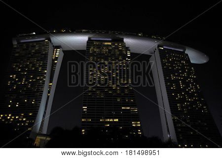 Singapore / Asia . APRIL 2017. Amazing night view of Marina Bay sands hotel in the Asian country of Singapore representation of world modern and futuristic architecture and travel destination landmark
