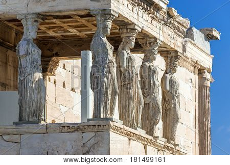 Close up on Caryatids sculptures of Erechtheion temple in Acropolis of Athens Greece