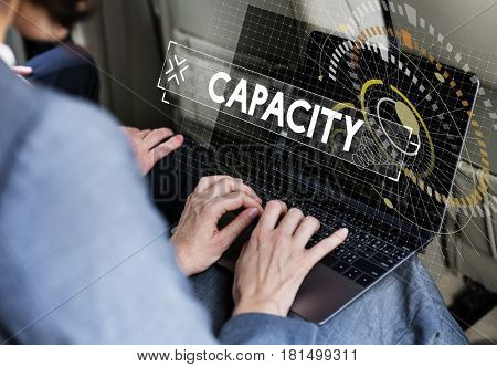 Capacity word graphic design with businessman using laptop photo