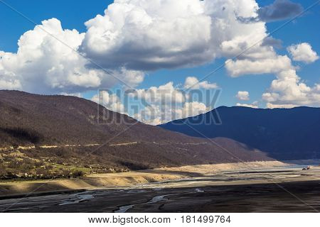 The mountain valley, hills, white clouds in the blue sky, a sunny weather, the nature of the North Caucasus, Georgia