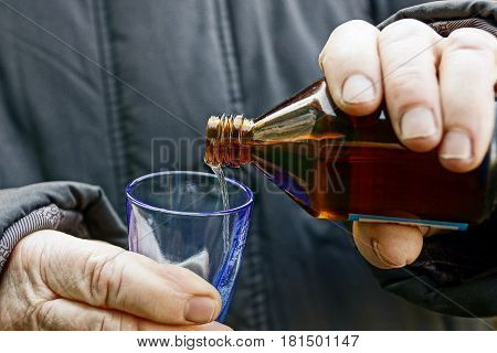 Transfusion of medicine from a bottle into a wine-glass