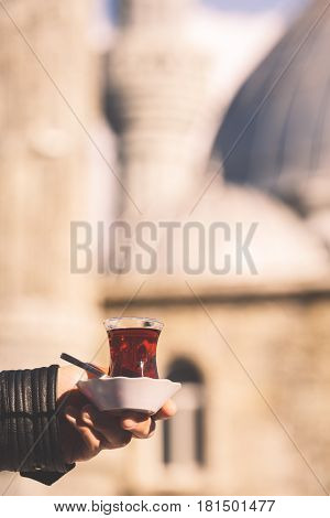 Hot Turkish Tea Outdoors With A Mosque At The Background. Turkish Tea And Traditional Turkish Cultur
