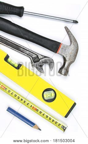 Various work tools on white background. Close up image