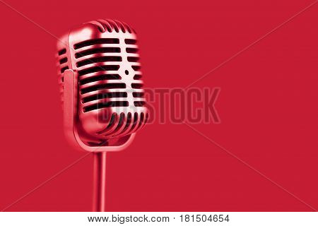 Retro microphone. ( Dynamic microphone ) on red background