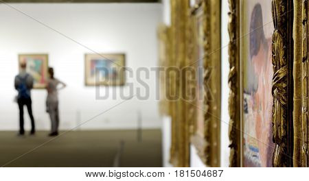 TEL AVIV, ISRAEL - APRIL 12, 2016: Young man and girl looks at a painting at the Museum of Art