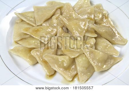 Turkish homemade manti, with potato and buttery ( Hingel - Sivas manti ) Traditional Turkish cuisine