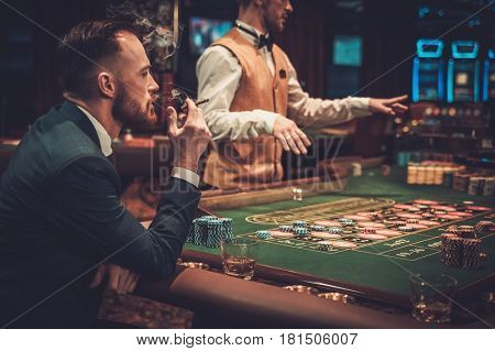 Upper class man gambling in a casino.