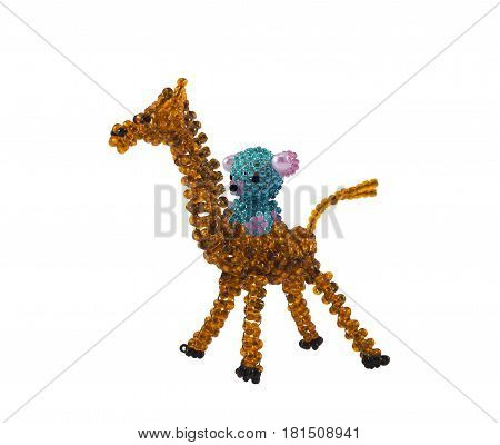 Isolated beaded giraffe with beaded bear on it.