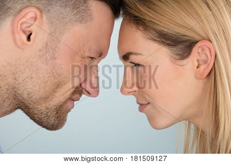 Close-up Of Young Couple Looking Angrily At Each Other