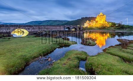 Dusk Over Loch At Eilean Donan Castle In Scotland, Uk