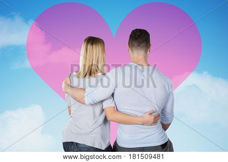 Rear View Of A Loving Couple Looking At Pink Heart On Sky