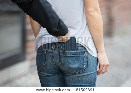 Thief Stealing Smartphone From woman's Jeans Pocket