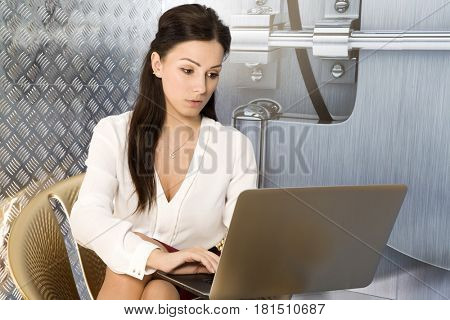 Portrait of a beauty young adult attractive pretty brunette businesswoman in office