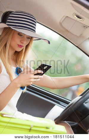 Woman Using Phone While Driving Her Car