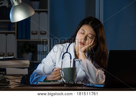 Exhausted Medical Personnel Sleeping With Coffee