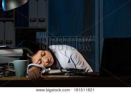 Doctor Feel Tired Sleeping On Desk Of Clinic