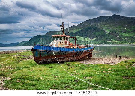 Rusty Shipwreck On Shore In Summer, Scotland, Uk