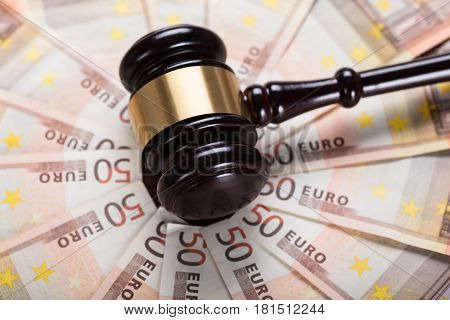 High Angle View Of The Judge Gavel Strike On Euro Banknote