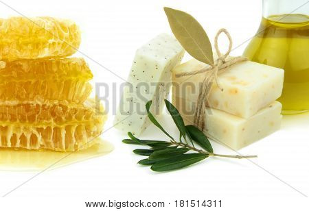Natural herbal soaps with honey, olive oil and daphne on white background