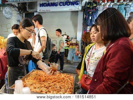 Hanoi Vietnam - Feb 19 2107 : a Women selling Topokki at Hanoi night walking street