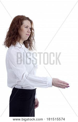 Young business woman extending her hand in greeting