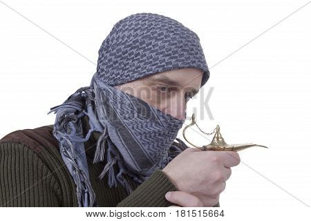 Arabic graying man with a lamp on a white background