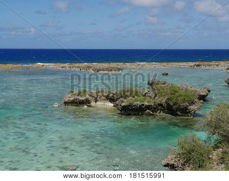 Rocks and Blue waters, Rota, Northern Mariana Islands Beautiful rock formations jutting out of the clear blue and green waters of Rota
