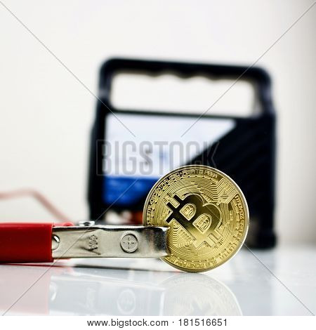 Bitcoin Gold Coin And Car Battery Charger