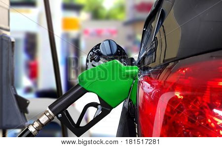 Car fueling petrol at station with blur background