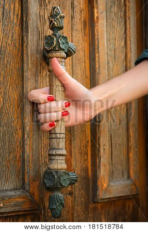 Beautiful women hand on vintage door knob.