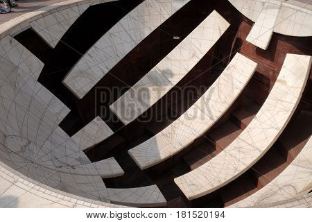JAIPUR, INDIA - FEBRUARY 16: Detail of the Jai Prakash Yantra, a sundial which measures altitudes, azimuths, hour angles and declinations in the Jantar Mantar. Jaipur, India on February 16, 2016.