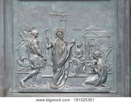 ROME, ITALY - SEPTEMBER 05: Bronze door with the image of the life of St. Paul: Paul reaches Rome and is welcomed by the faithful, basilica of Saint Paul Outside the Walls, Rome on September 05, 2016.