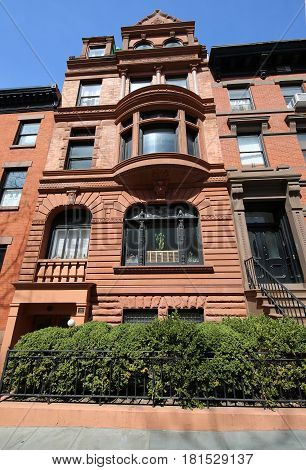 BROOKLYN, NEW YORK - APRIL 11, 2017: New York City brownstones at historic Brooklyn Heights neighborhood. Brooklyn Heights is an affluent residential neighborhood within the New York City borough of Brooklyn