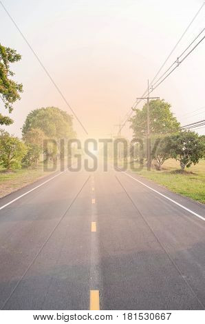 Straight road. The road is straight and trees on either side. Light At The End. Background.