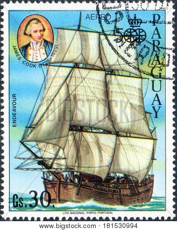 UKRAINE - CIRCA 2017: A postage stamp printed in Paraguai shows Sailing Ship Endeavor and portrait James Cook from the series Discovery of America 500th anniversaries circa 1985