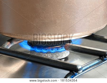 Saucepan being heated on a gas hob