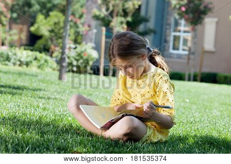 portrait of happy girl having good time in summer environment