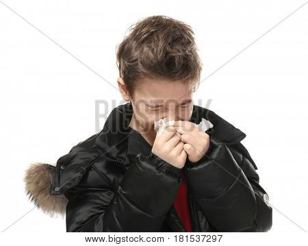 Ill little boy with tissue isolated on white