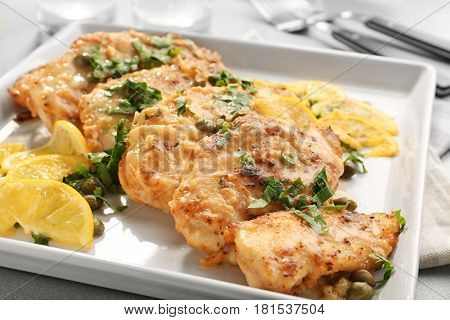 Tasty Italian chicken piccata with lemon on plate