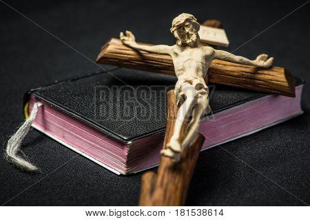 Black Prayer book and Jesus Christ on cross