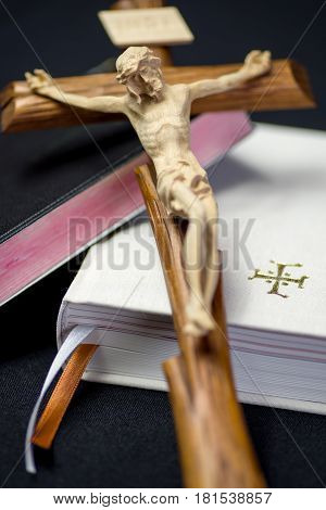 Black and white prayer books and Jesus Christ on cross