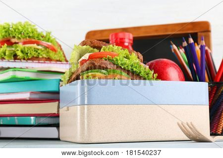 School lunch with sandwich and apple on table