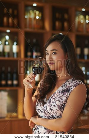 Portrait of lovely woman with glass of red wine