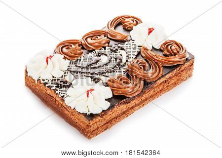 Condensed Milk And Chocolate Cake Decorated With Cream Flowers Isolated On White