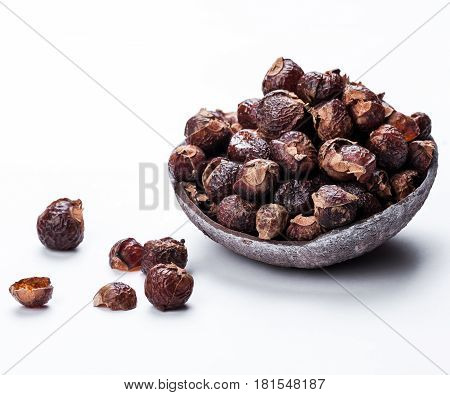 soap nuts on a white background in the coconut. Care products. natural, organic and